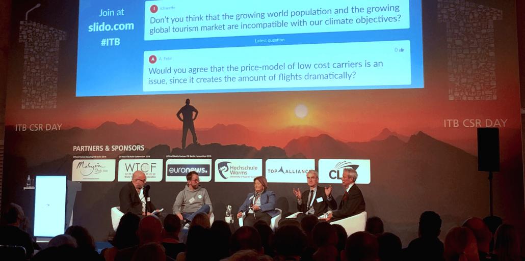 Eine Diskussionsrunde auf der ITB zum Thema Klimawandel und Reisen